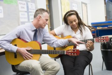 Guitar teacher and student
