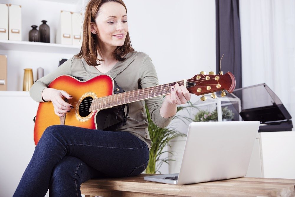 Woman learning guitar